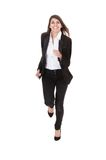 Happy businesswoman running over white background Stock Photography