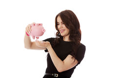 Happy businesswoman saving money in piggybank. Isolated on white Stock Images