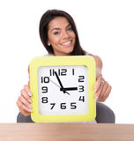 Happy businesswoman showing big clock Royalty Free Stock Photos