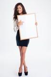 Happy businesswoman showing blank board Stock Image