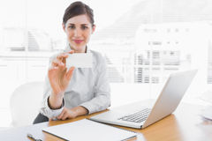 Happy businesswoman showing blank business card Stock Photography