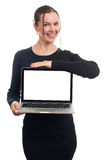 Happy businesswoman showing blank laptop screen Royalty Free Stock Images