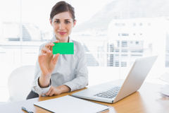 Happy businesswoman showing green business card Stock Photography