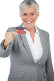 Happy businesswoman showing her credit card Stock Photo