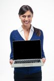 Happy businesswoman showing laptop computer screen Royalty Free Stock Photos