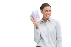 Happy businesswoman showing lots of money Royalty Free Stock Photography