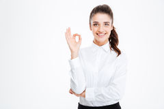 Happy businesswoman showing ok sign isolated on a white background Stock Photography