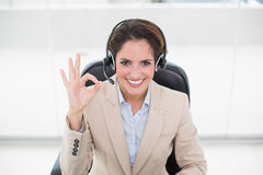 Happy businesswoman showing okay sign Stock Images