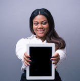 Happy businesswoman showing tablet computer screen Royalty Free Stock Images