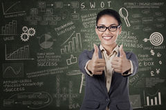 Happy businesswoman showing thumb up Royalty Free Stock Photos