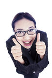 Happy businesswoman showing thumbs up Stock Images