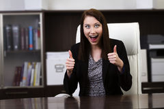Happy businesswoman showing thumbs up sign Royalty Free Stock Photography