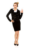Happy businesswoman shows OK sign Stock Image