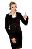 Happy businesswoman shows OK sign Stock Photography