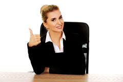Happy businesswoman shows thumbs up.  Stock Photos