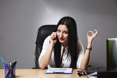 Happy businesswoman shows thumbs up. Royalty Free Stock Photography