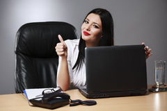 Happy businesswoman shows thumbs up. Stock Photo