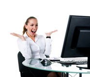 Happy businesswoman sits at the computer Stock Photo