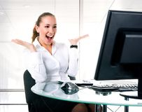 Happy businesswoman sits at the computer Stock Image
