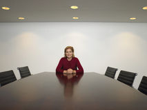 Happy Businesswoman Sitting In Conference Room Stock Photography