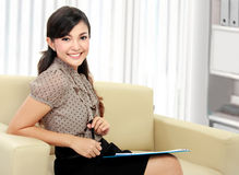 Happy businesswoman sitting in the couch Royalty Free Stock Photography