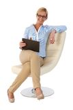 Happy businesswoman sitting in design chair Royalty Free Stock Images