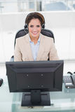 Happy businesswoman sitting in front of computer Royalty Free Stock Photos
