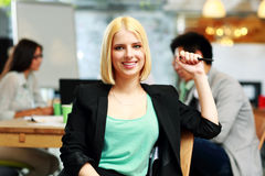 Happy businesswoman sitting in office Royalty Free Stock Photos