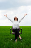 Happy businesswoman sitting on recliner Stock Photography