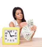 Happy businesswoman sitting at the table with money Stock Image