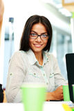 Happy businesswoman sitting at the table Stock Image