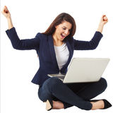 Young businesswoman celebrating a success working with laptop Royalty Free Stock Photos