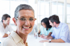 Happy businesswoman smiling at the camera Royalty Free Stock Image