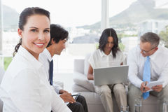 Happy businesswoman smiling at camera Stock Image