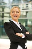 Happy businesswoman smiling in the city Royalty Free Stock Image