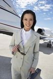 Happy Businesswoman Standing On Airfield Royalty Free Stock Photography
