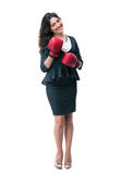 Happy businesswoman standing in boxing gloves Stock Image