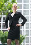 Happy businesswoman standing in the city Royalty Free Stock Image