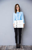Happy businesswoman standing with folders Stock Image