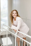 Happy businesswoman standing in hallway Royalty Free Stock Photography