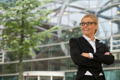 Happy businesswoman standing outdoors with arms crossed Royalty Free Stock Photo