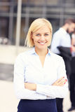 Happy businesswoman standing outside modern building Royalty Free Stock Image