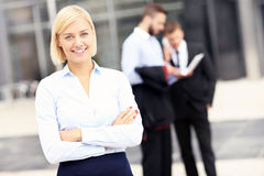 Happy businesswoman standing outside modern building Stock Photography