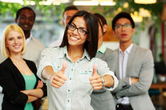 Happy businesswoman standing with thumbs up Royalty Free Stock Photography