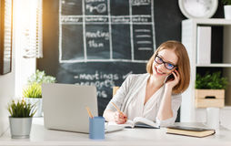 Happy businesswoman student with computer and mobile phone Royalty Free Stock Photo