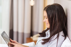 Happy businesswoman with tablet pc in hotel room Stock Photo
