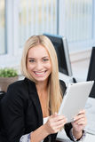 Happy businesswoman with a tablet-pc Stock Photography