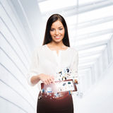 A happy businesswoman with a tablet pc Royalty Free Stock Photos