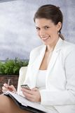 Happy businesswoman taking notes Stock Images