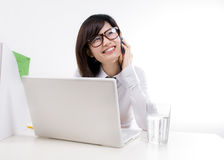 Happy businesswoman talking on the cellphone Stock Photos